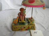 Mechanical Toy= Celluloid Doll With Rotating Umbrella, Rocker And Action Do