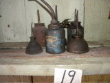 Seven (7) Antique Oil Cans.