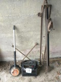 Garage= Batter Charger; Old Bumper Jack; 4-way Tire Iron, Auto Brush.