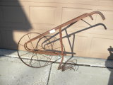 Antique Single Wheel Metal Cultivator.