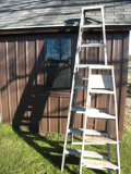 Aluminum 7 Ft Step Ladder; Wood 4 Ft Step Ladder.