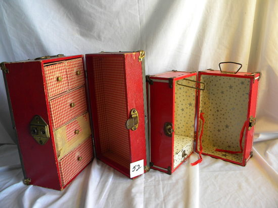 "Pair of Doll Cases= (A) 6X6X10""; (B) 7X7x12""."