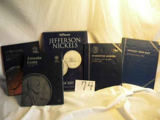 Coin books.   Jefferson Nickels; Washington Quarters; Jefferson Nickels; Lincoln Cent.