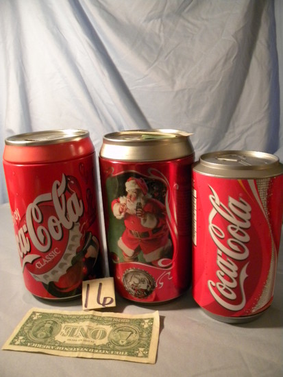 Coca Cola= Pair Of coca cola Cans that are coin Banks; Coaster Can.