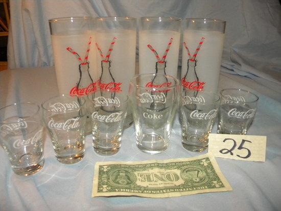 Coca Cola= 4 Milk Glasses; 5 Shot Glasses; 1 Wine Glass.