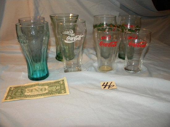 Coca Cola= (8)water Glasses
