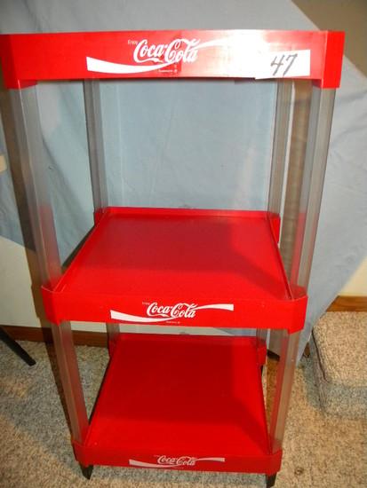 Coca Cola= Three Tier Plastic Organizer Stand.