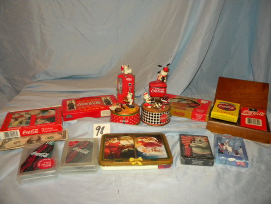 Coca Cola= Pair Of Music Boxes; Fourteen Decks Of Cards.