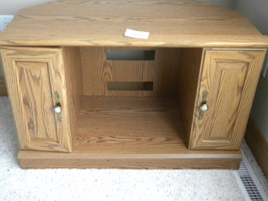 "Oak Entertainment Stand, 2 Doors, 22 1/2""h X 29 1/2""w X 21""d."
