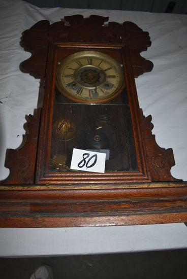 """Wind-up Pendulum Wall Clock, Roman Number Face; 22 1/2 L X 15""""w."""