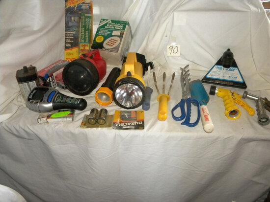 Bud-l-scoop; Flash Lights; Batteries; Water Timmer; Garden Tools.