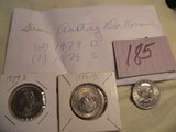 Coins=Susan B. Anthony Silver Dollars= Pair 1979 D; One 1979 S.