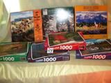 Seven Boxes Of Puzzles.
