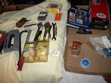 Two Flats= Book On Plumbing; Tools; Bath Drain Assembly; Staples And More.