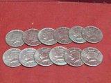 (12) Kennedy Half Dollars