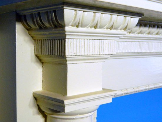 Ornate Wooden Mantel with Fluted Columns