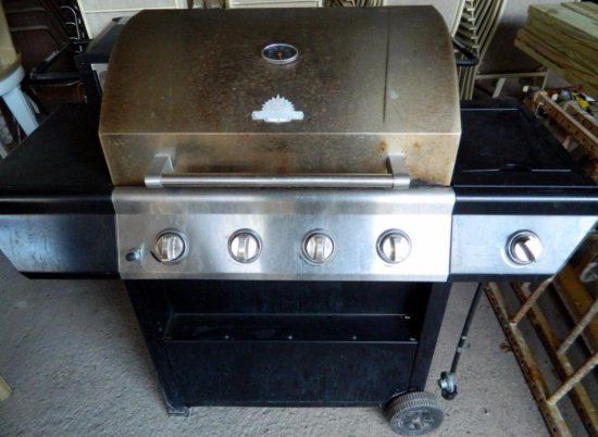 Two GrillMaster 4-Burner Propane Stainless Gas Grills with Side Burners