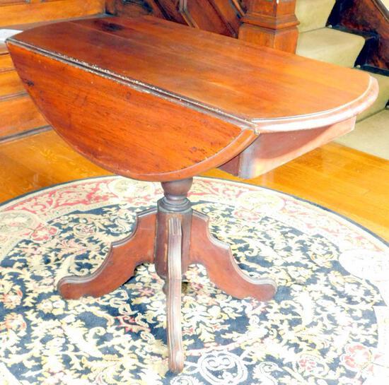 Double Drop-leaf Round Pedestal Table