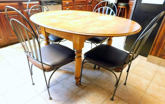 Wooden Dining Table with Four Black Metal Chairs