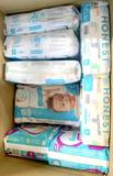 Assorted Honest Co. and Pampers Diapers sizes 1-6, 24 Units
