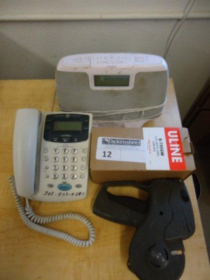 LOT OF IPOD CLOCK DOCKING STATION, GE WHITE PHONE, PRICE GUN AND PRICE LABE