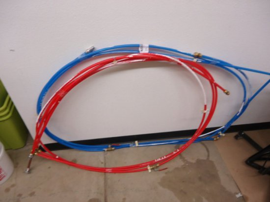 LOT OF TWO RED AND BLUE PLASTIC FLUID LINES AS PHOTOGRAPHED