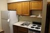"""Room 100 Kitchenette - 88"""" upper cabinets - 36"""" Base - 88"""" Island"""
