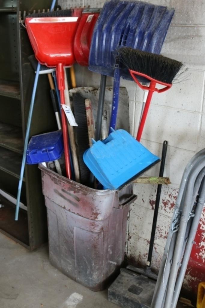 Barrel with brooms & shovels