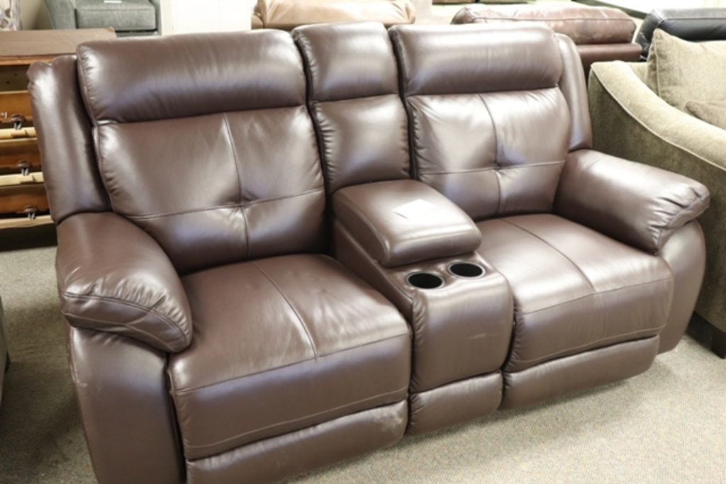 Brown leather rocking sofa with center arm rest