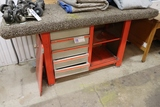 Metal shop cabinet with carpeted top