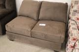 Brown love seat