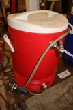 Portable cooler with stainless coil