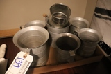 Box flat of aluminum measuring cups