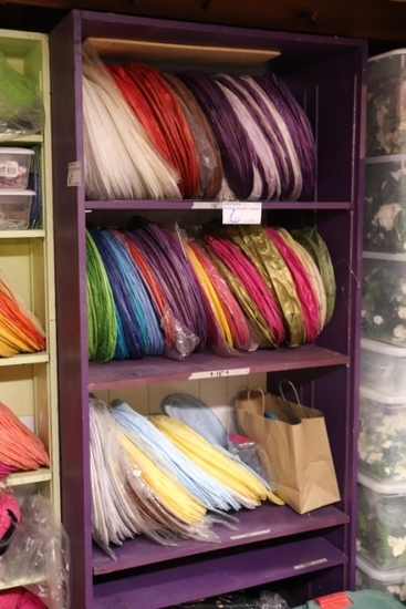 Shelf of misc. size & colored paper lanterns - some may have frames - most