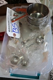 Tote of new stainless measuring cups