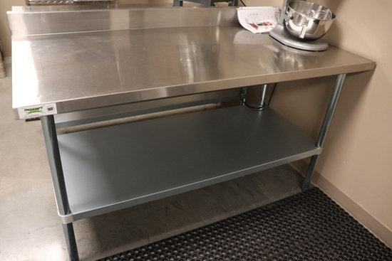 "Regency 600T3060G stainless table with galvanized under shelf and 4"" back s"