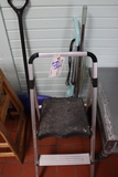 Step stool with shovel and vacuum