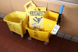 All to go - mop bucket with caution signs
