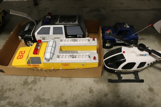 All to go - 4 Plastic emergency toys - helicopter, 2 cop cars, rescue fire