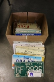 Box of assorted Iowa year license plates