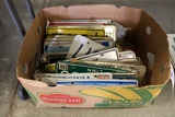 Large box of assorted state license plates