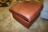 Brown vinyl portable ottoman missing one roller - 24 x 24