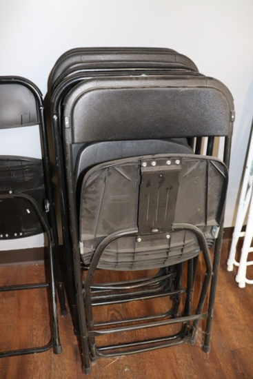 Times 10 - black poly folding chairs