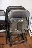 Times 10 - black poly folding chairs