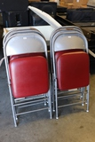 Times 6 - Metal folding chairs with red vinyl seats