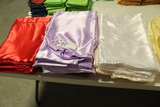 All to go - Red, purple, & white satin table linens