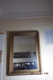 Mirror with ornate gold frame