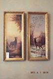 Pair of stag deer paintings in gold gilded frames