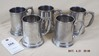 Five pewter tankards with glass bottoms