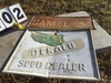 "Group of 2 metal signs - Camel 12"" x 32"" (rusted), Dekalb Speed Dealer 23"" x 29"" (minor damage)"